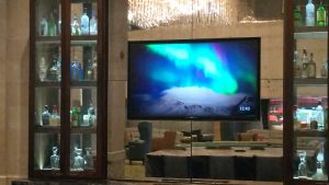 flat screen display behind bar counter